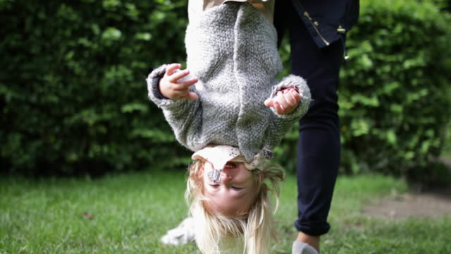 mother and daughter in park playing - upside down stock videos & royalty-free footage