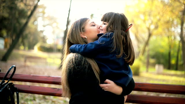mother and daughter in park - bench stock videos & royalty-free footage