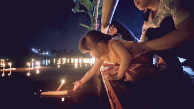 mother and daughter in thai dress in loi krathong traditional festival - cultures stock videos & royalty-free footage