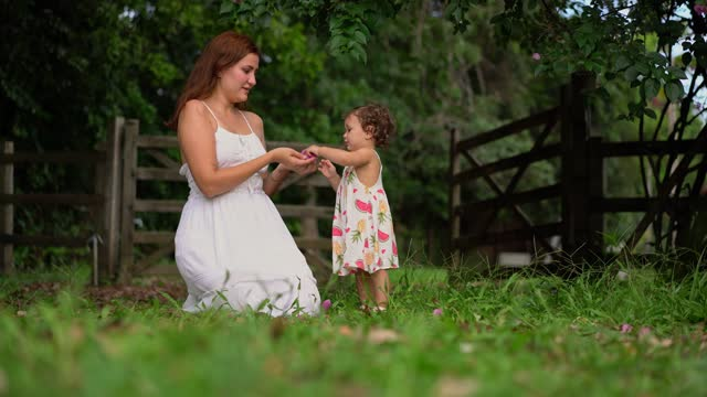 mother and daughter in the farm garden - gender symbol stock videos & royalty-free footage