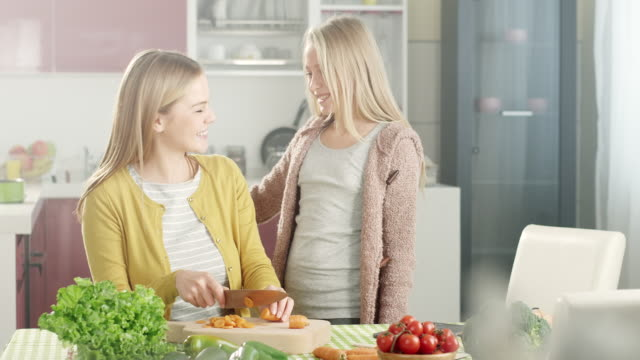 mother and daughter in the kitchen - condiments stock videos and b-roll footage
