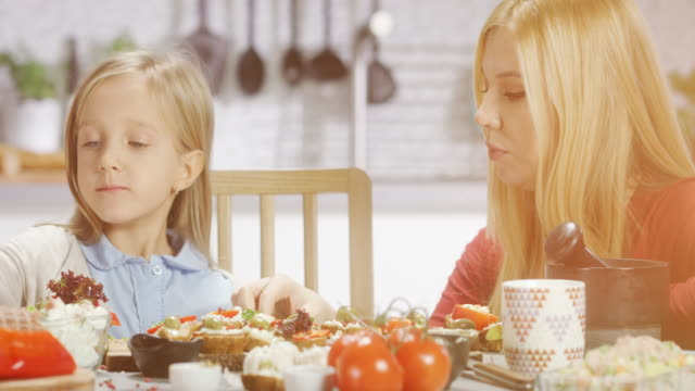 mother and daughter in the kitchen - ham stock videos and b-roll footage