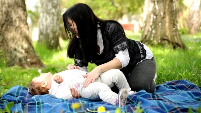 mother and daughter in the park. - tickling stock videos & royalty-free footage