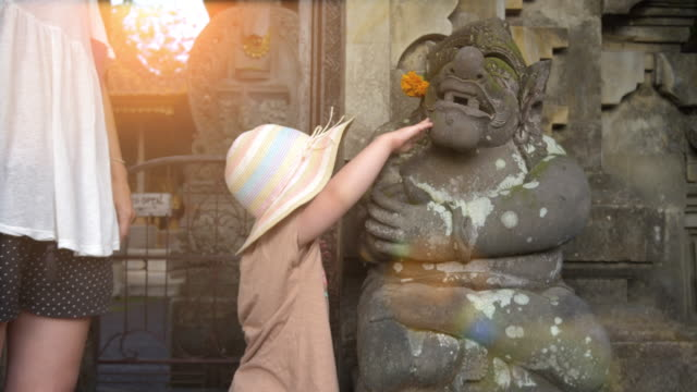mother and daughter in ubud statue - ceremony stock videos & royalty-free footage
