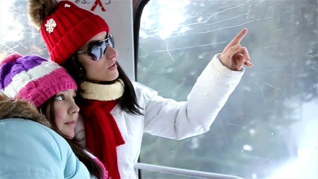 mother and daughter inside the ski lift - seggiovia video stock e b–roll