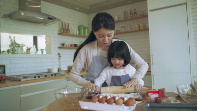 mother and daughter kneading dough in the kitchen - baking stock videos & royalty-free footage