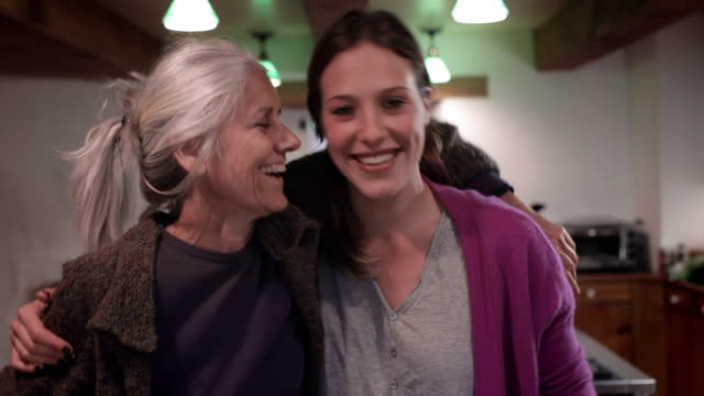 vidéos et rushes de ms mother and daughter laughing in kitchen / kingston, new york, usa  - parents