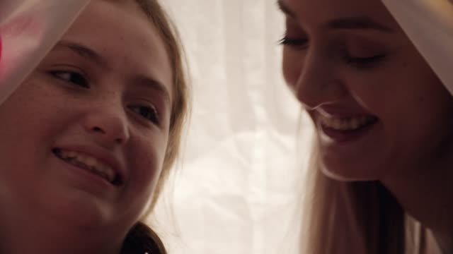 mother and daughter laughing together - tied bow stock videos & royalty-free footage