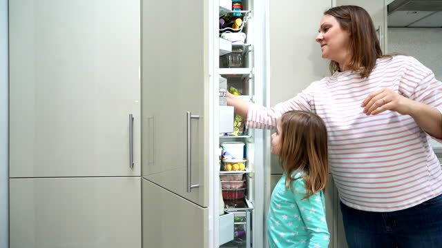mother and daughter looking in fridge - single mother stock videos & royalty-free footage