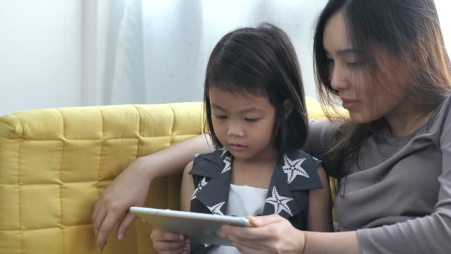 mother and daughter looking on digital tablet - daughter stock videos & royalty-free footage