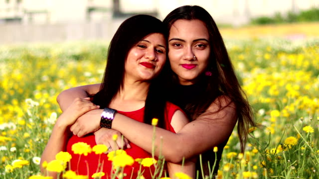 mother and daughter loving portrait - mid adult stock videos & royalty-free footage