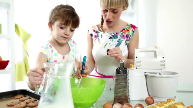 HD: Mother and daughter making cookies.