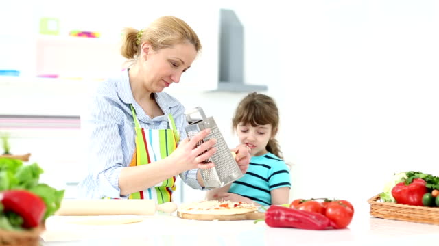 hd: mother and daughter making pizza. - grater utensil stock videos and b-roll footage