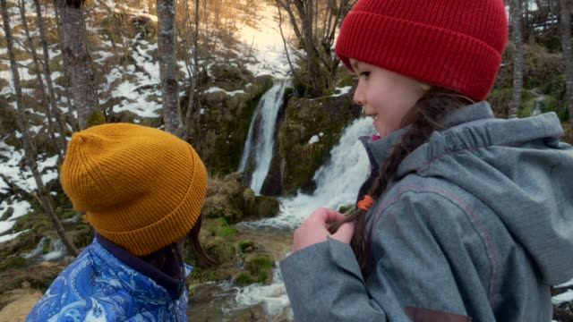 mother and daughter observing nature having fun while learning - spring flowing water stock videos & royalty-free footage