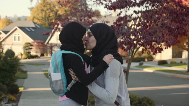 4k uhd: mother and daughter of middle eastern descent  embracing - rucksack stock videos and b-roll footage