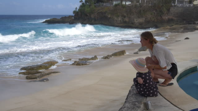 mother and daughter on beach - two generation family stock videos & royalty-free footage