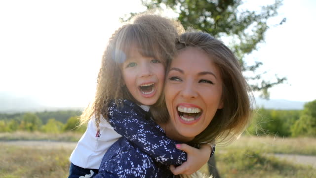 mother and daughter on beautiful spring day - piggyback stock videos & royalty-free footage
