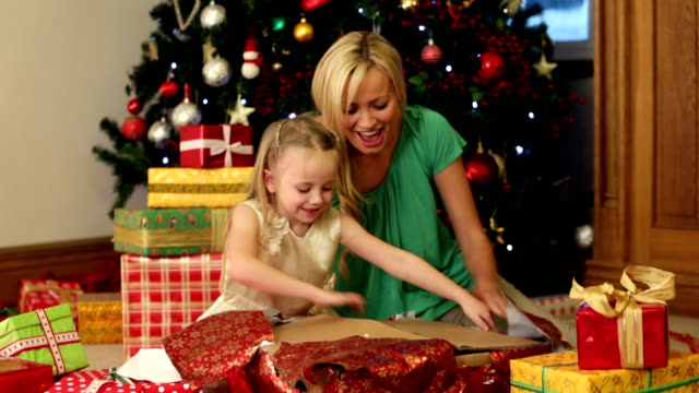 mother and daughter on christmas morning - christmas morning stock videos & royalty-free footage