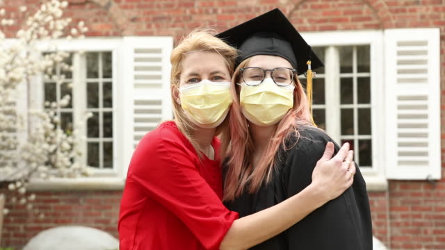 mother and daughter pandemic graduate class of 2020 - graduation stock videos & royalty-free footage