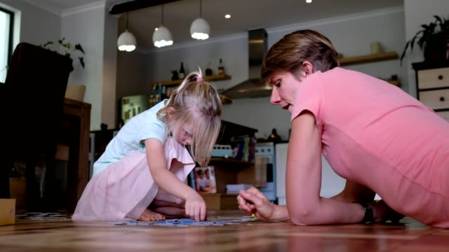 mother and daughter playing a board game together - board game stock videos & royalty-free footage