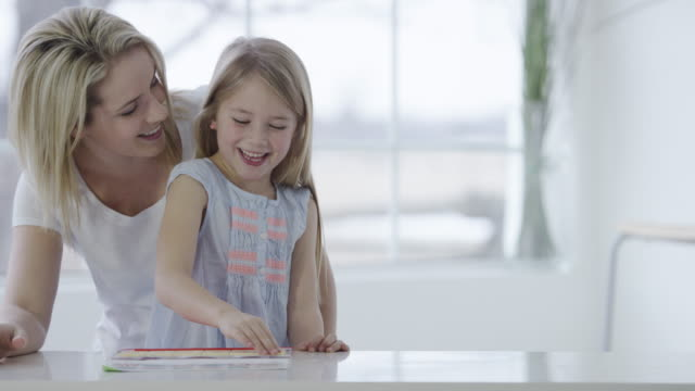 mother and daughter playing an educational game - blond hair stock videos & royalty-free footage