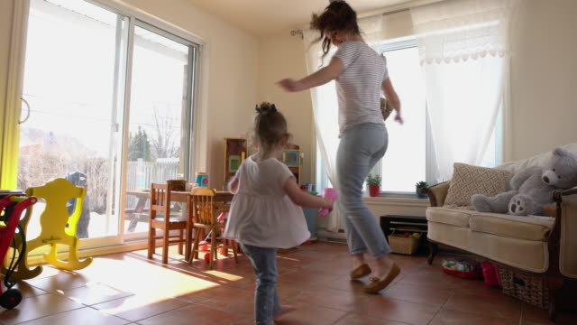 mother and daughter playing at home - messing about stock videos & royalty-free footage