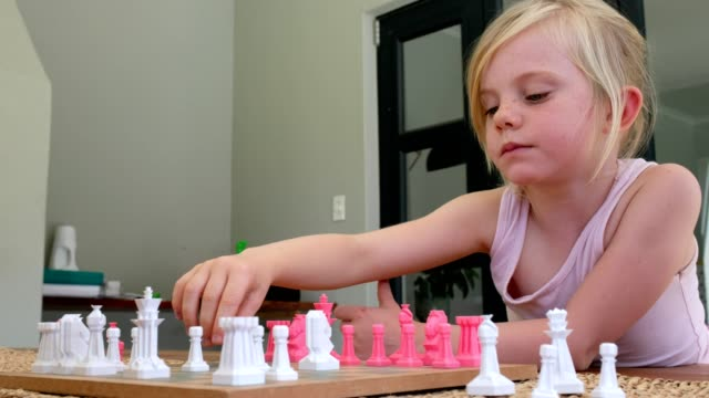 mother and daughter playing chess - board game stock videos & royalty-free footage