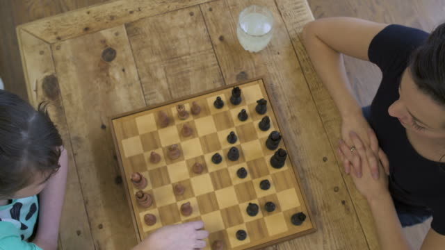 mother and daughter playing chess - chess stock videos & royalty-free footage