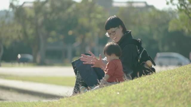 mother and daughter playing in the park. - japanese ethnicity stock videos & royalty-free footage