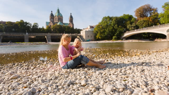 ms mother and daughter playing in the sun at river beach - familie mit zwei generationen stock-videos und b-roll-filmmaterial