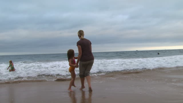 mother and daughter playing in the surf - see other clips from this shoot 1156 stock videos & royalty-free footage