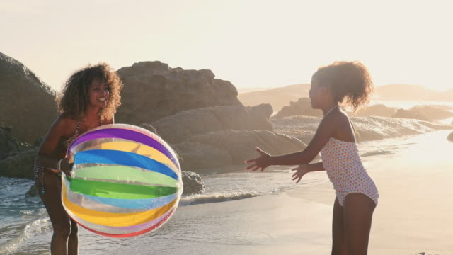 mother and daughter playing on beach - 10 11 years stock videos and b-roll footage