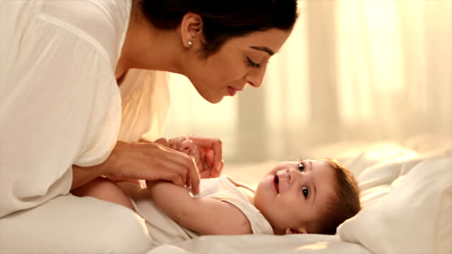 ms mother and daughter playing on bed / delhi, india - voice stock videos & royalty-free footage