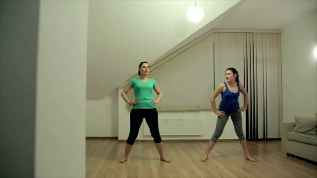 mother and daughter practice aerobics at home - overweight yoga stock videos & royalty-free footage