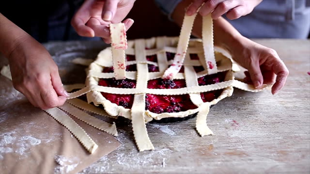 mother and daughter preparing cherry pie - baking stock videos & royalty-free footage