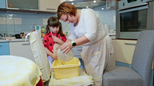 mother and daughter preparing dough at home - mixing stock videos & royalty-free footage