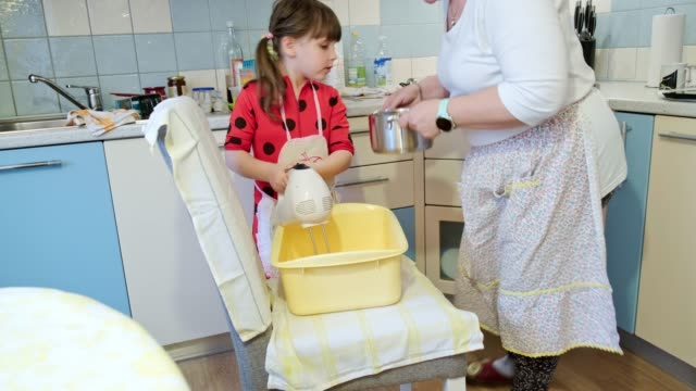 mother and daughter preparing dough at home - yeast stock videos & royalty-free footage