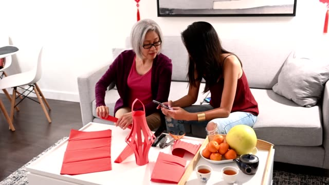 mother and daughter preparing for chinese new year - 65 69 years stock videos & royalty-free footage