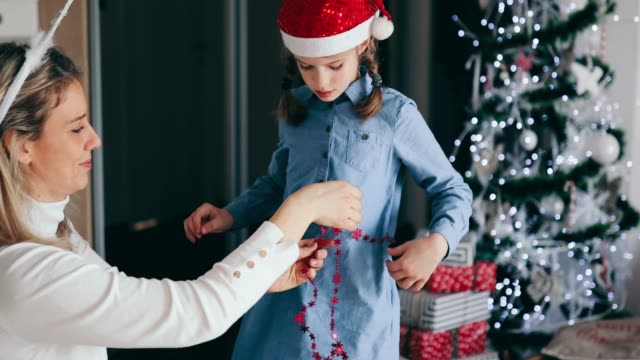 mother and daughter preparing for christmas - dressing up stock videos & royalty-free footage