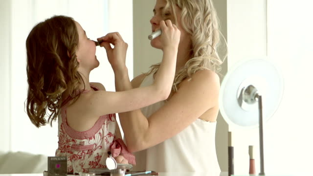 slow motion - mother and daughter putting on make up - make up stock videos and b-roll footage