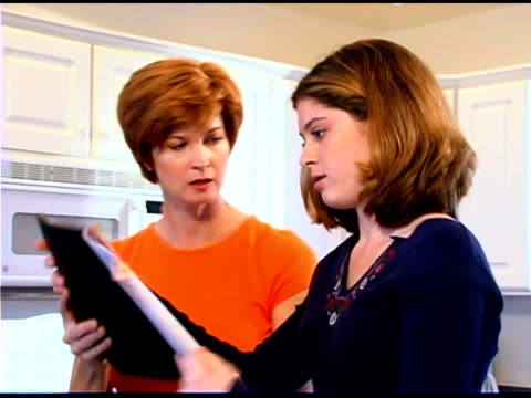mother and daughter reading calendar - see other clips from this shoot 1335 stock videos and b-roll footage