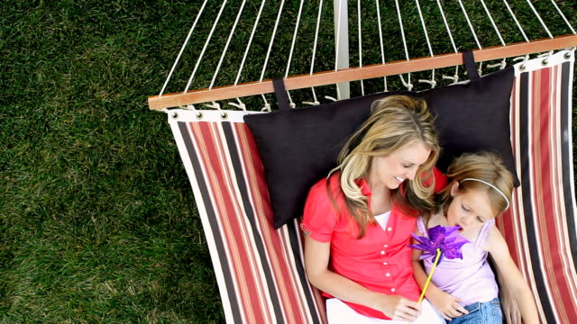 mother and daughter relaxing in a hammock - front or back yard stock videos & royalty-free footage