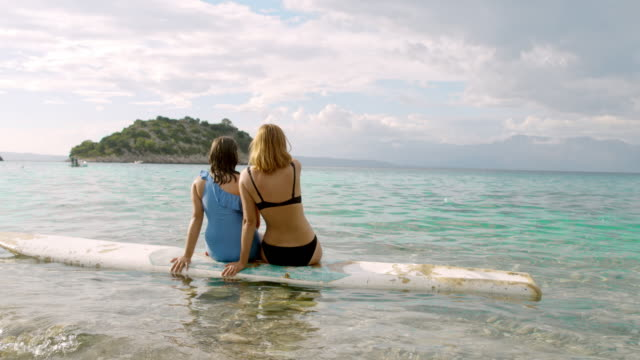 ms mother and daughter relaxing,floating in ocean and looking at island,peljesac,croatia - swimwear stock videos & royalty-free footage