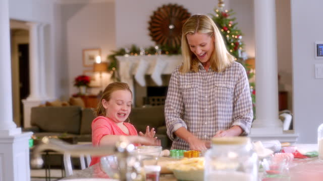 mother and daughter roll cookie dough into balls, drop and pound on kitchen counter-top (dolly-shot) - role model stock videos & royalty-free footage