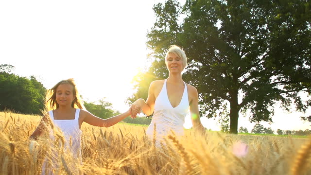 HD SUPER SLOW-MOTION: Mother And Daughter Running In Wheat
