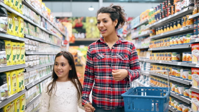 mother and daughter shopping in supermarket - retail stock videos & royalty-free footage