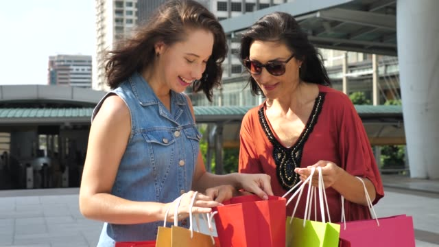 mother and daughter shopping with shopping bag - russian culture stock videos & royalty-free footage