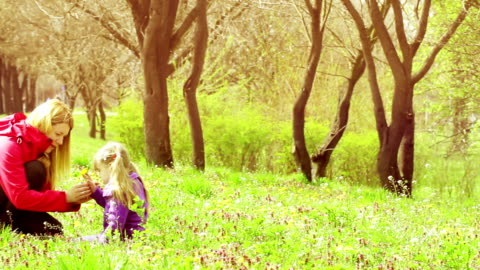 mother and daughter sitting in meadow in spring - eastern european culture stock videos & royalty-free footage