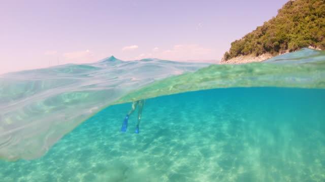 ms mother and daughter snorkeling underwater in sunny blue ocean - teenage girls stock videos & royalty-free footage