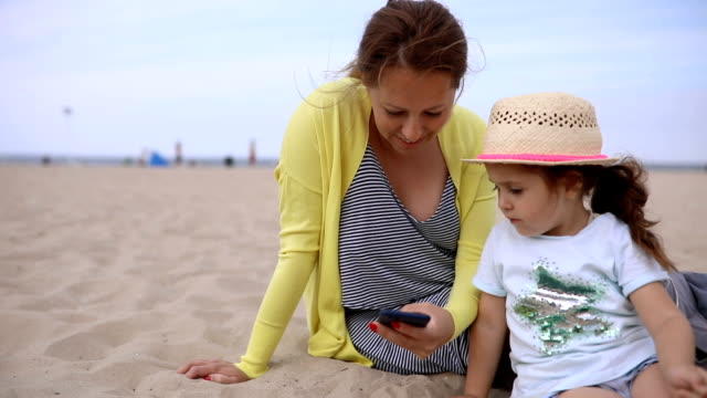 mother and daughter spending time together on a beach - 30 34 years stock videos & royalty-free footage